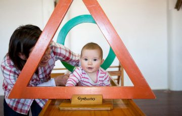 GymbaROO BabyROO Sydney West NSW Baby Classes Child Development Child Crawling Through Triangle with Mother's Help